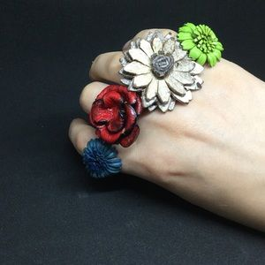 Collection of 4 adjustable leather flower rings